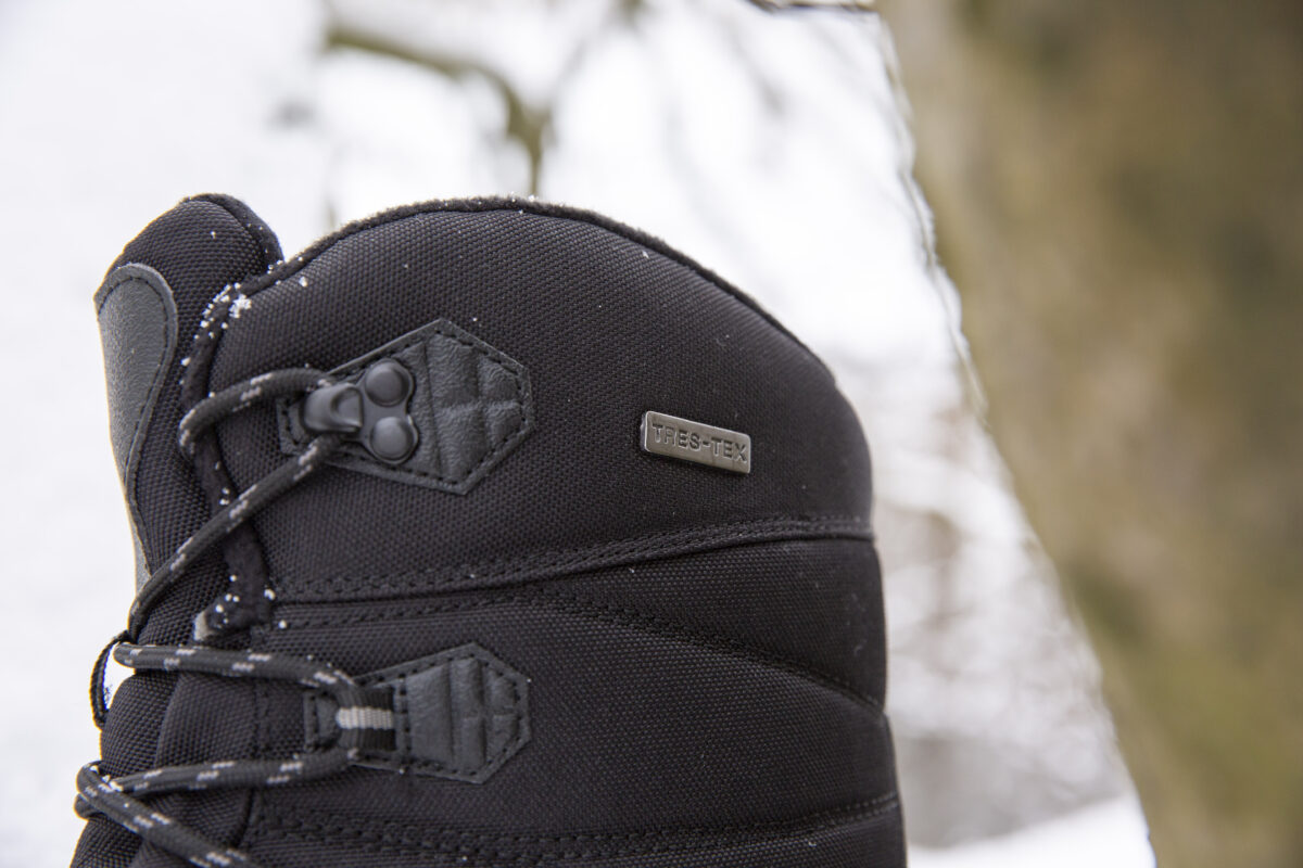 A close up of the top of a best-selling Trespass walking boot in the middle of winter